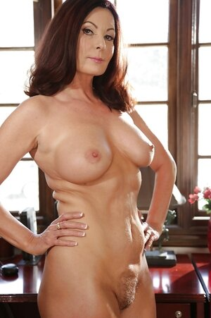 Middle-aged actress Magdalene St. Michaels shows her sexy body in the office
