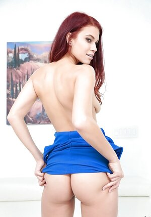 Bonny ginger chick wears a blue dress in contrast and slowly pulls it up