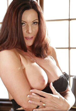 Well-hung adult star gets bored in her office and unclothes on camera