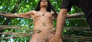 Submissive broad enjoys outdoor bondage domination performed by master