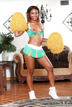 Individual pictures of black cheerleader with small jugs and pierced nipples