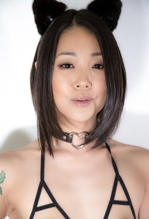Erotically attractive Oriental kitty with small titties doesn't mind being obedient