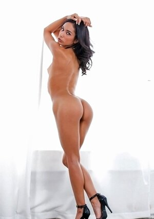 Skinny Latina with little tits climbs on high chair after taking off clothes