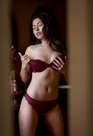 Drop-dead charming female Melissa Moore caresses herself in luxurious lingerie