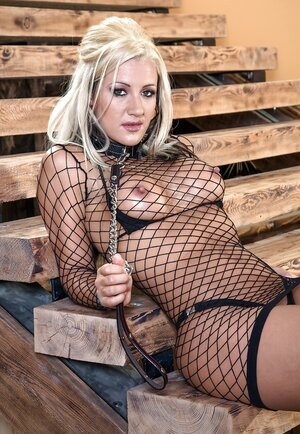 Hoe in leather outfit dominates blonde in fishnet dress and small-tittied kitten