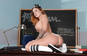 Erotic student with tattooed body takes her breasts out and furthermore spreads pussy lips