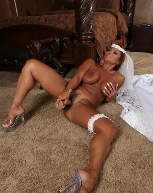Red-haired Soccer mom with big hooters toys soggy vag before wedding ceremony