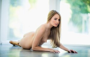 Chick with straight hair decides to take off clothes in front of a glass wall