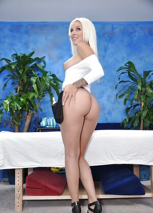 Floozy with platinum blonde hair manifests her boobs and bum to attract customers