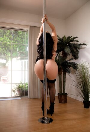 Brunette deletes black dress and additionally does the same with red lingerie by pole