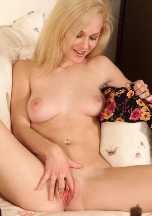 Blonde floozy plays with a large red toy shoving it inside her pink slit