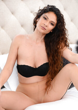 Individual pictures of curly middle-aged porn model Jessica Torres in pantyhose